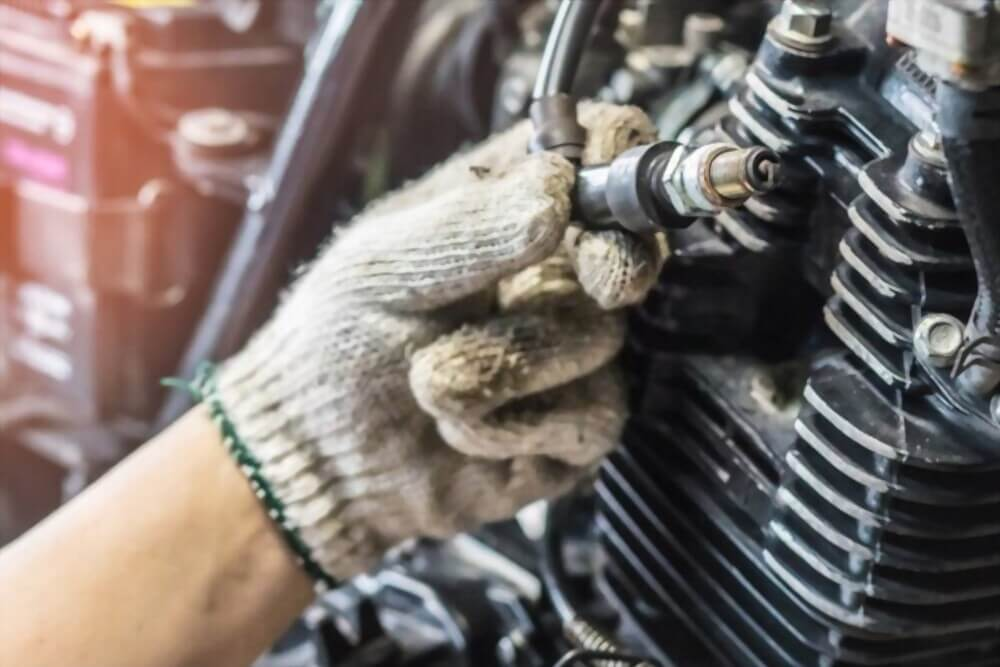 Check Spark Plugs and Ignition System