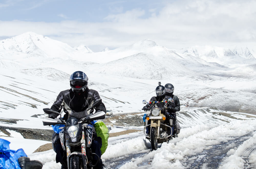 How do I keep my feet warm while riding a motorcycle
